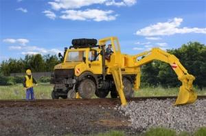 Kibri 16307 Unimog U2400 kolejowo-drogowy z koparką