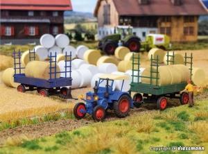 Kibri 38999 H0 Traktor Lanz Bulldog z oświetleniem / przyczepy / bele siana